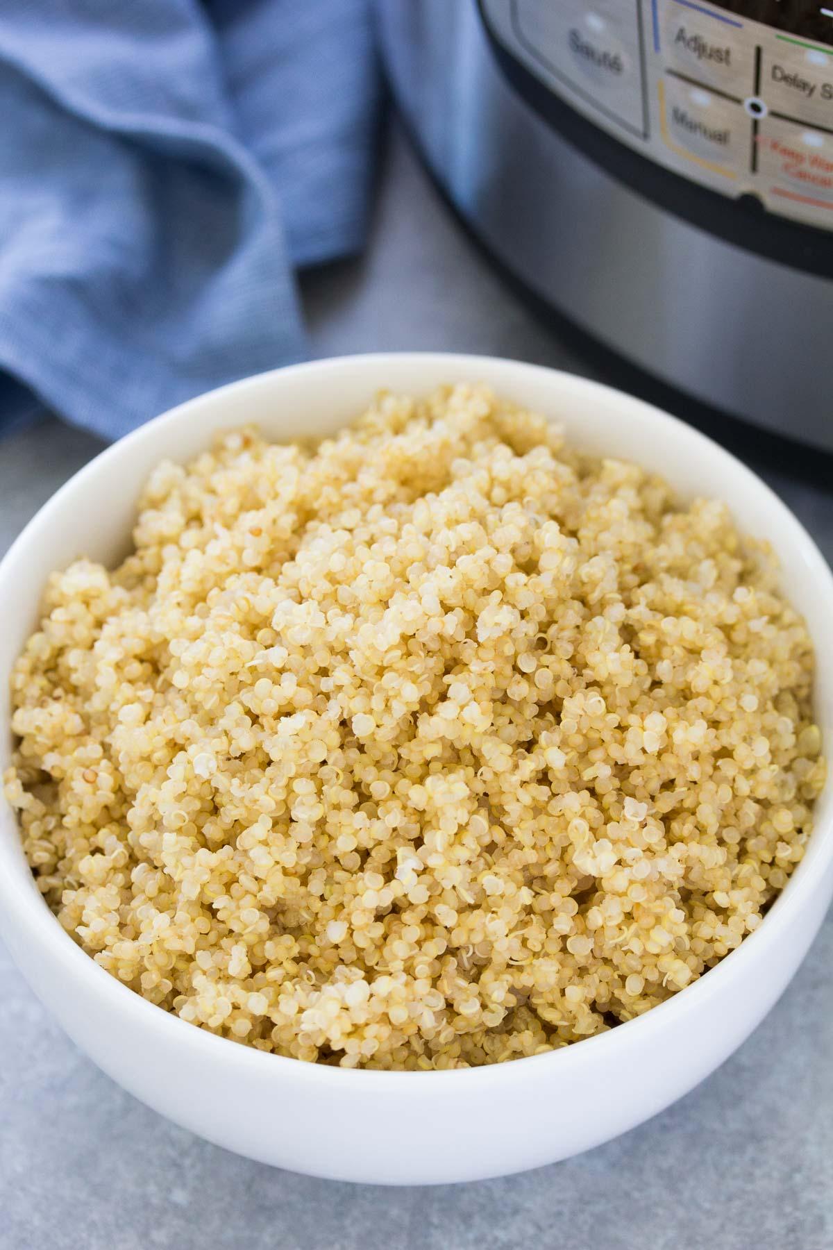 instant pot quinoa in a white serving bowl