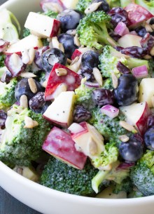 close up of broccoli salad in a white bowl