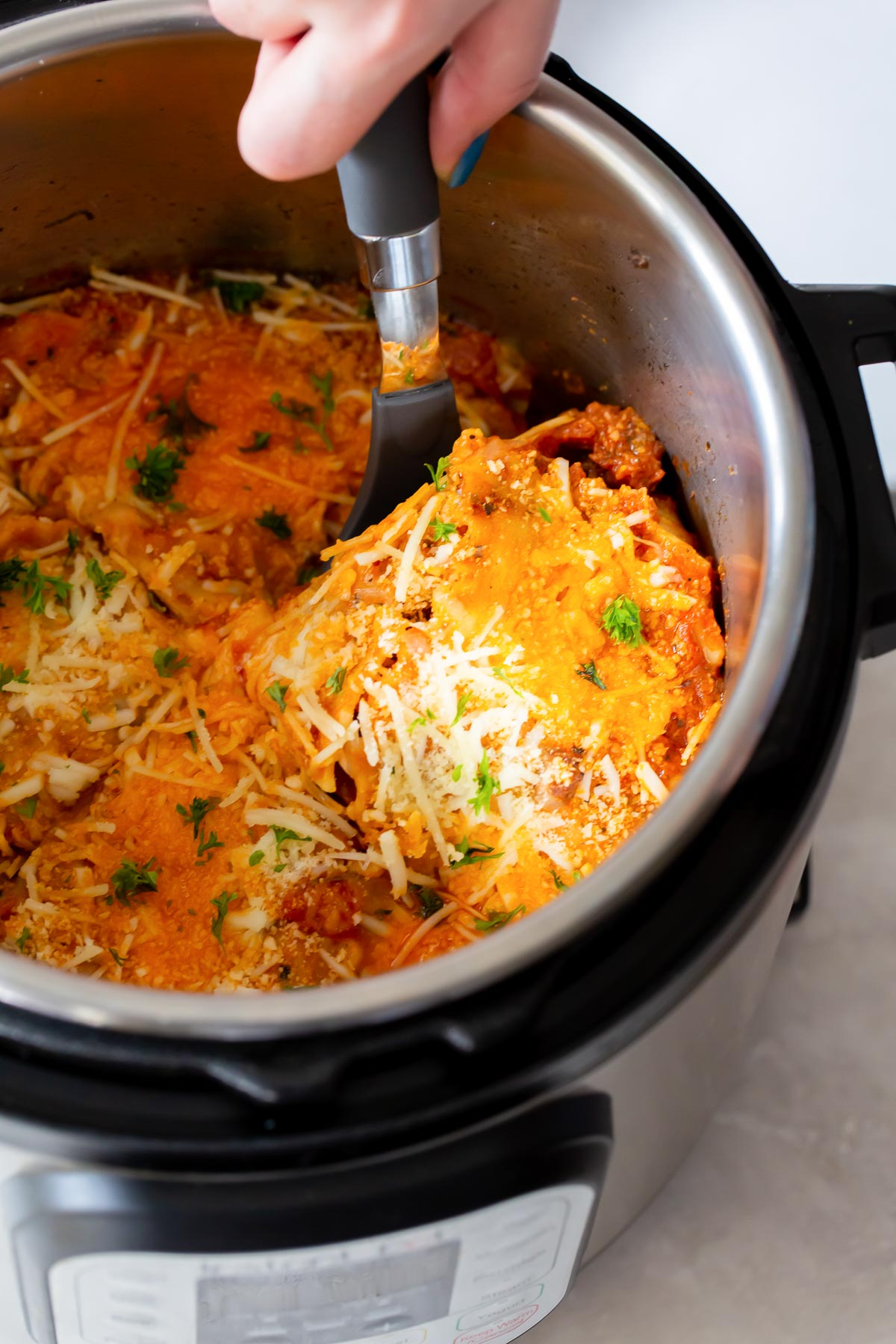 serving a slice of lasagna from the instant pot