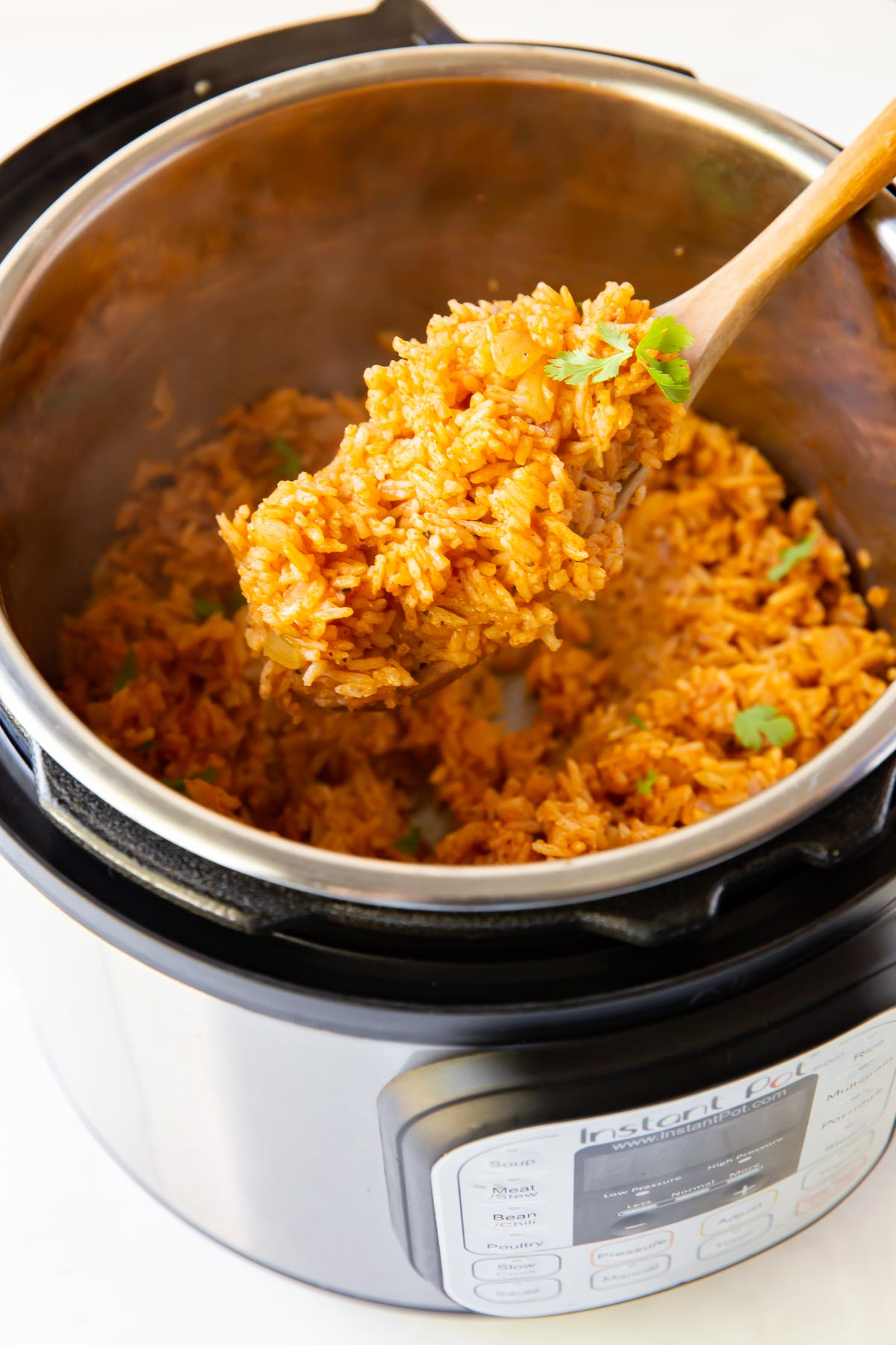 spoonful of mexican rice held over instant pot