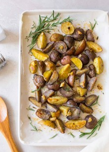 overhead photo of oven roasted potatoes on baking sheet