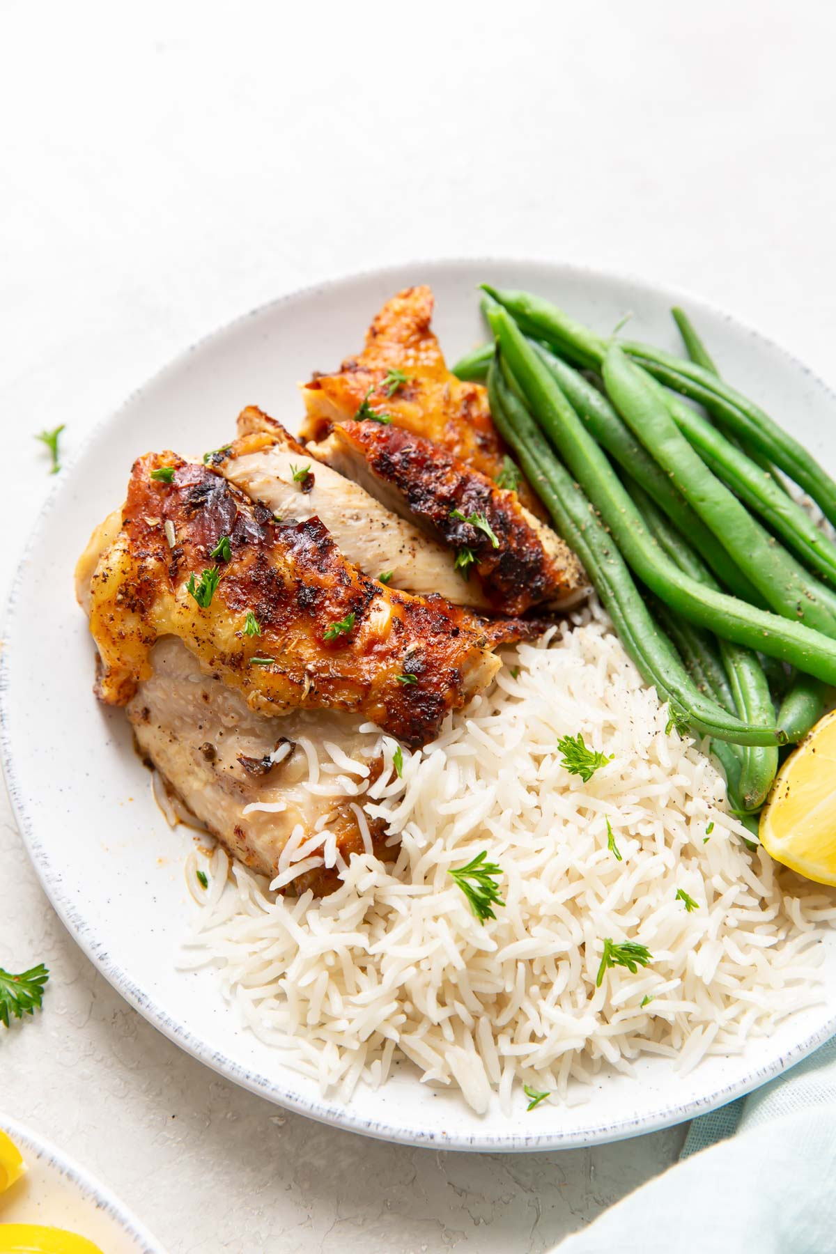 chicken served on a plate with rice and green beans