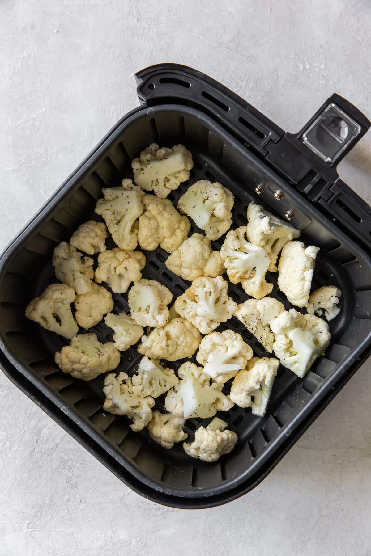 seasoned cauliflower in air fryer basket