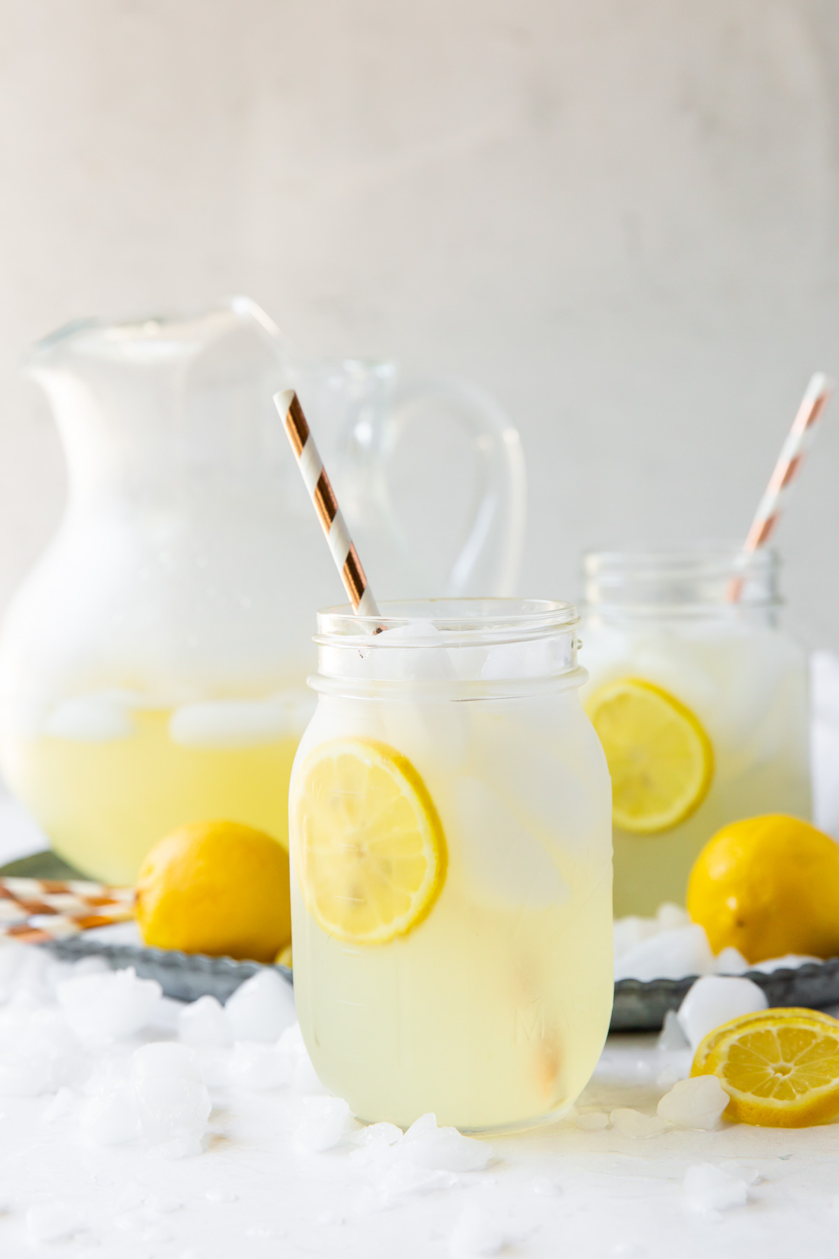 two glasses and a pitcher of homemade lemonade