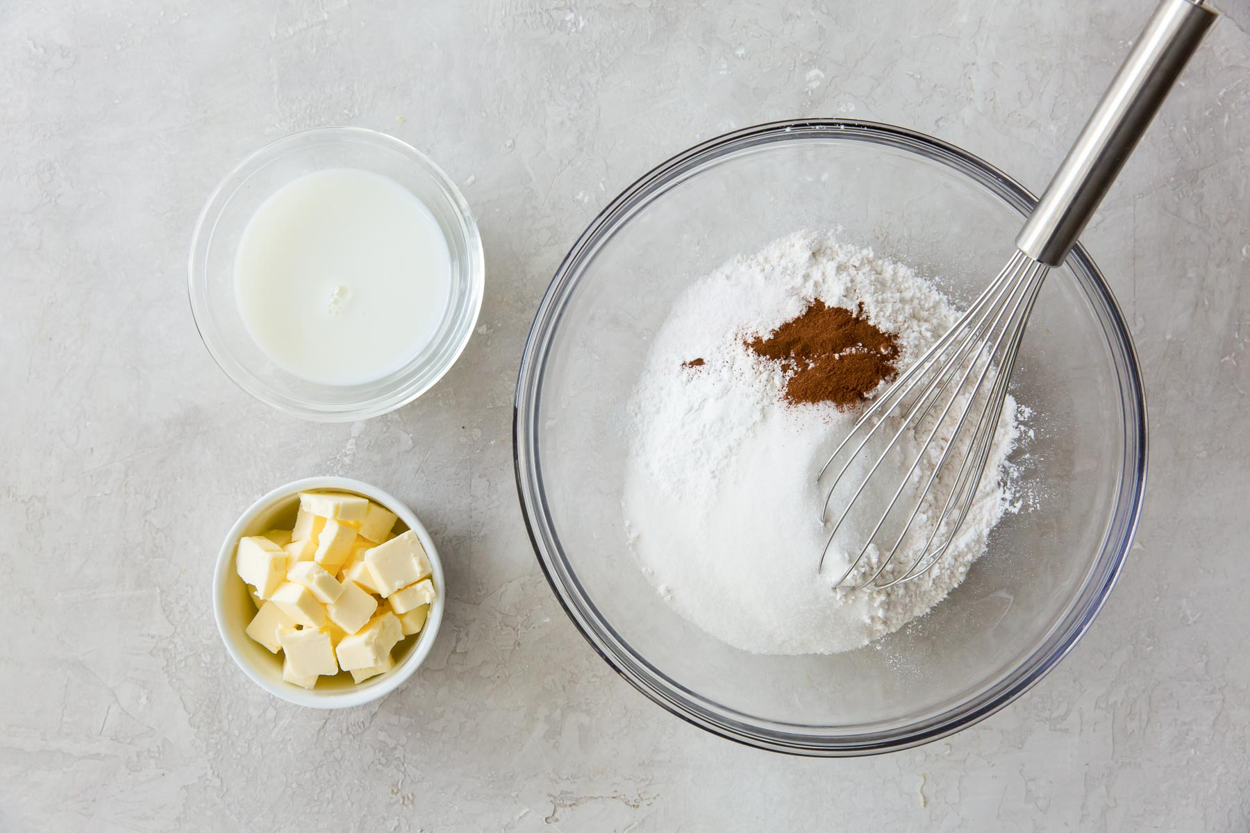 ingredients for peach cobbler topping in mixing bowl with a whisk