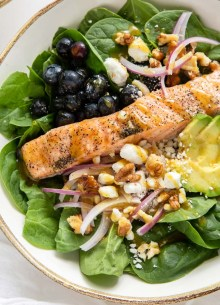 Spinach and salmon salad with avocado, goat cheese, walnuts, blueberries and honey mustard dressing.