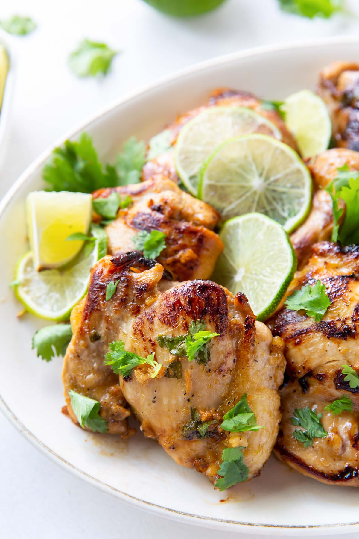close up of cilantro lime chicken thighs on a serving platter