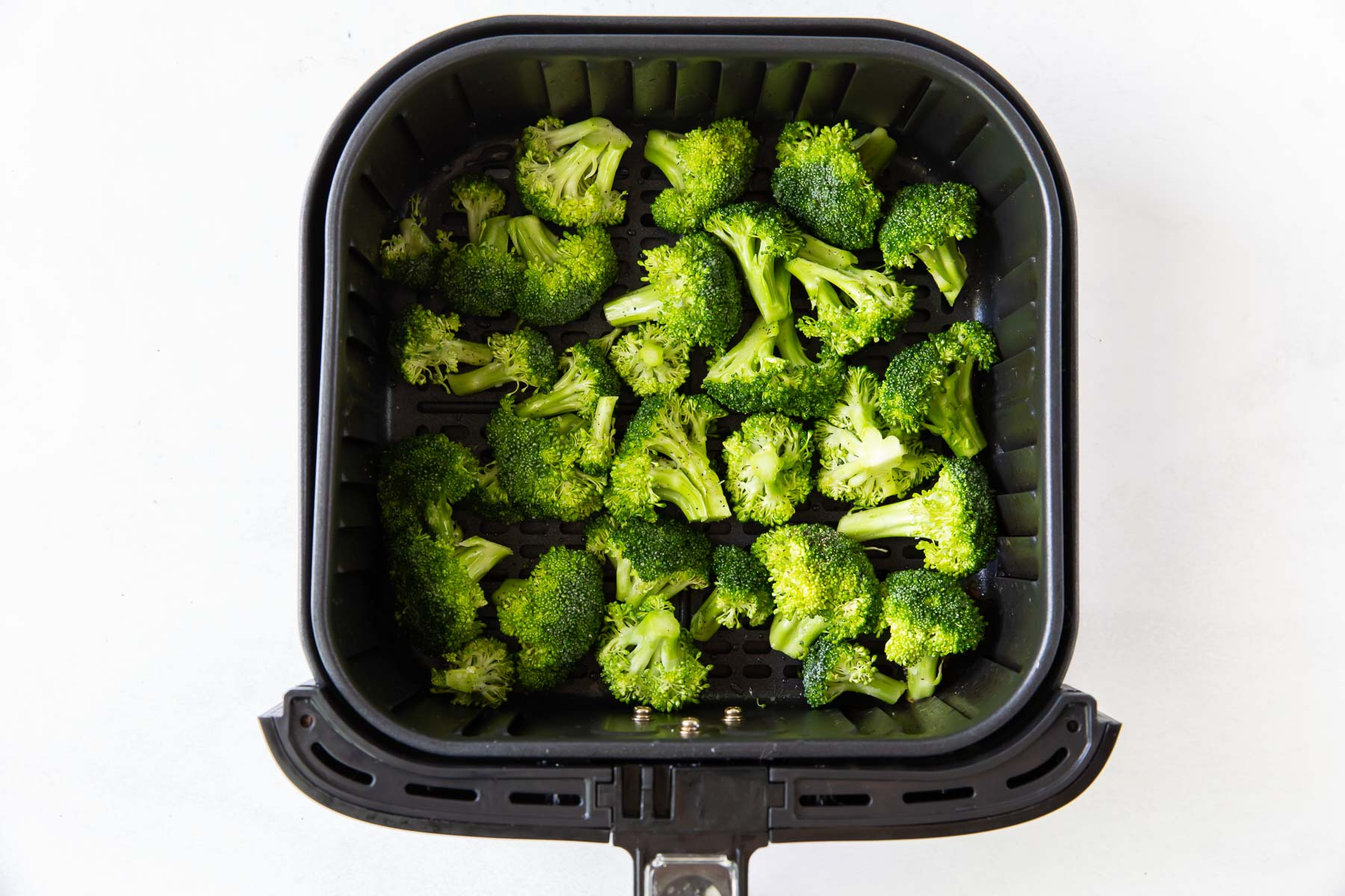 broccoli florets in a single layer in air fryer