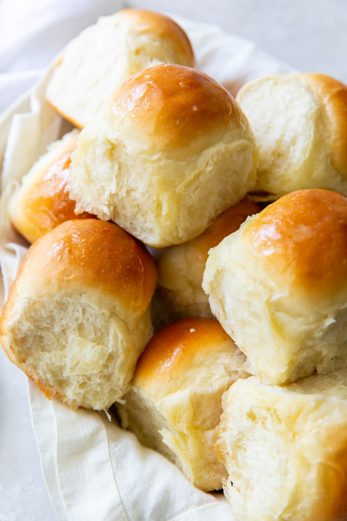 dinner rolls served in a cloth napkin lined bowl