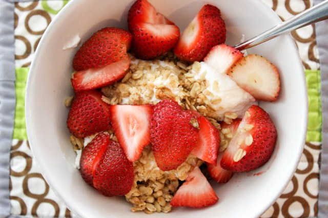 greek yogurt topped with strawberries and granola