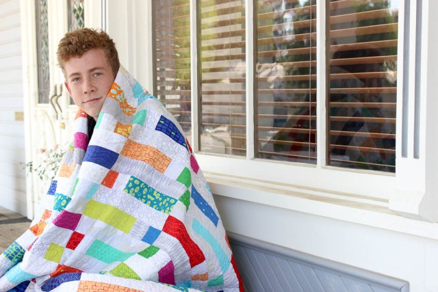 boy with quilt