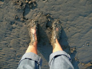 Bare feet in mud