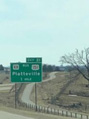 Highway sign - Platteville 1 mile
