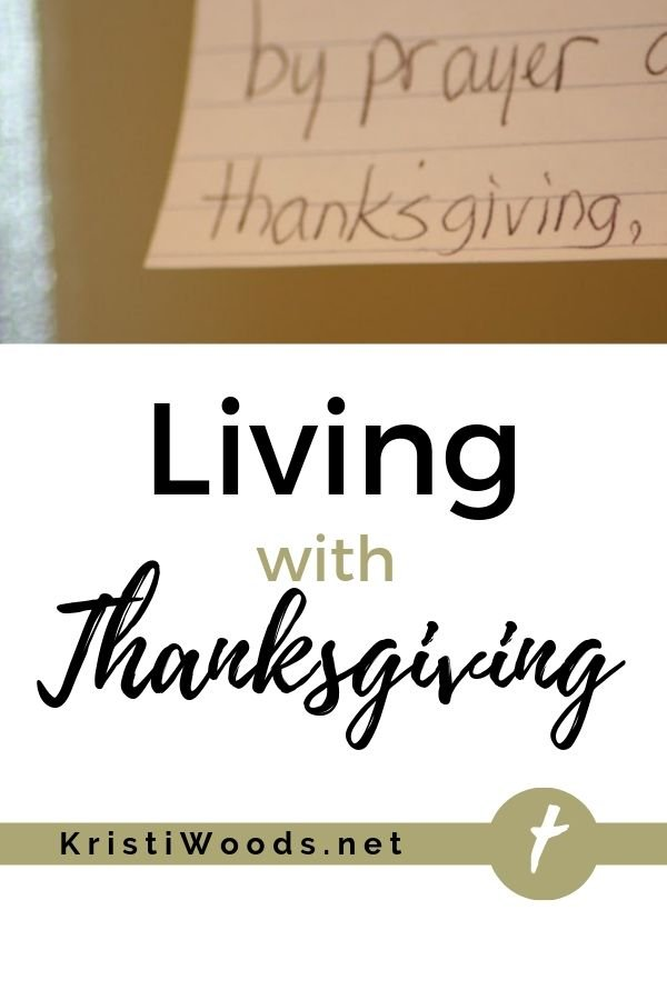 Index card with the word thanksgiving on it, underneath the title Living with Thanksgiving
