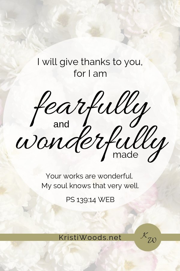 flowers with PS 139:14 written in black lettering