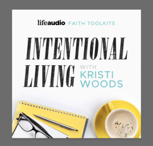 Notepad, pen, glasses, and drink on a white surface with the title of this Christian podcast