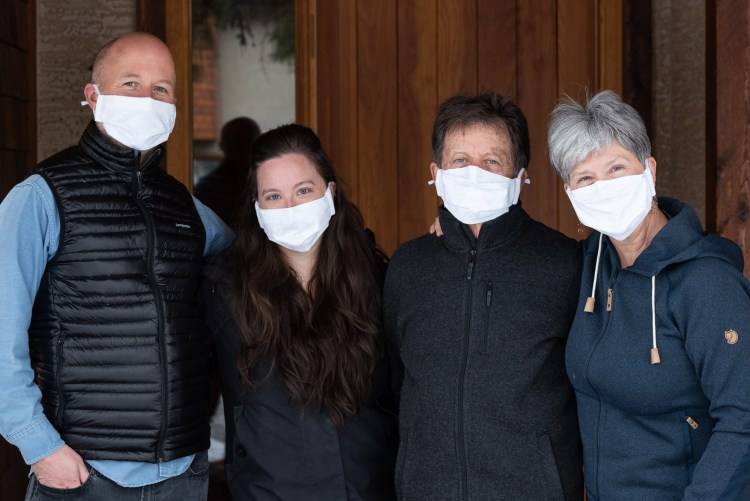 A family wearing face masks during the covid-19 pandemic.