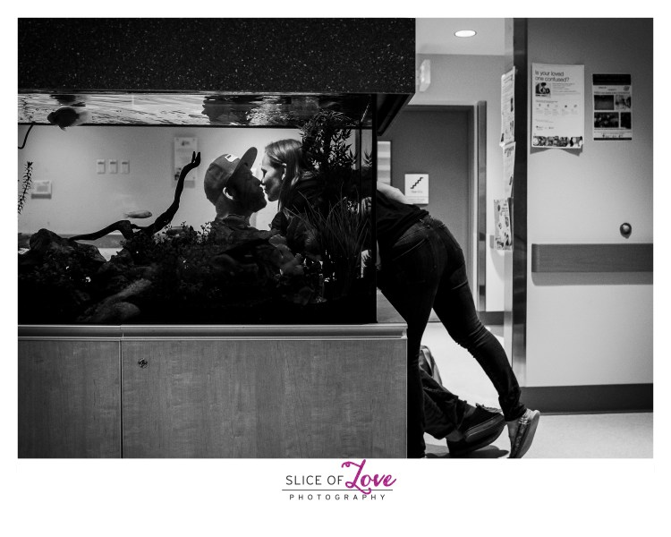 The parents of a heart warrior comfort each other while waiting for their son to come out of heart surgery. Image by Slice of Love Photography