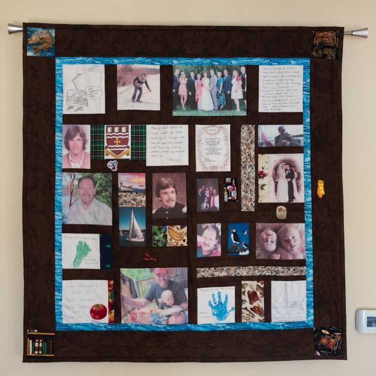 A commemorative quilt containing images and memories.