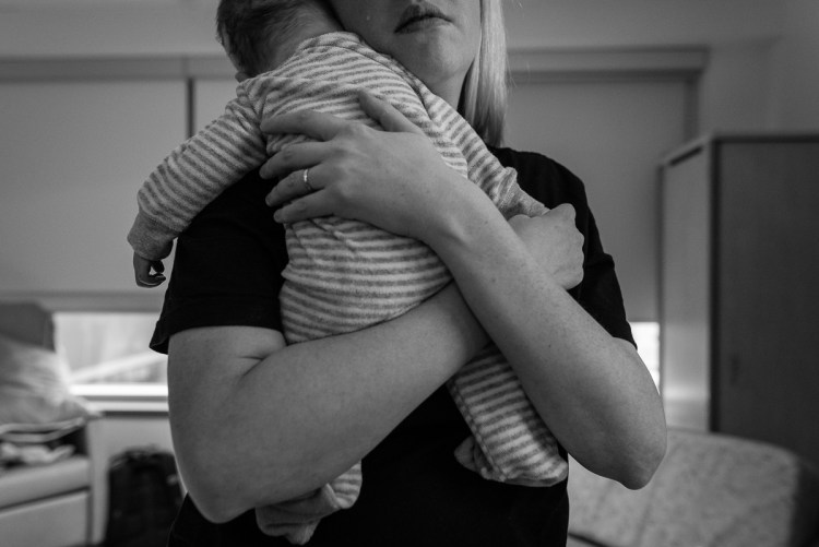 A mother holds her son after he has died.