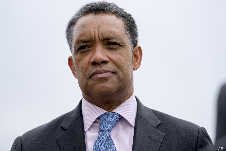 FILE - District of Columbia Attorney General Karl Racine, attends a news conference near the White House in Washington, Feb. 26, 2018. Racine has issued subpoenas to the National Rifle Association and its related charitable foundation as part of an investigation into financial improprieties inside the powerful lobbying organization.