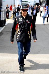 Kimi walks through the paddock on Sunday morning