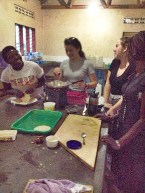 Sheila, Tori, Christina, and I in the campus kitchen learning how to make chapati.