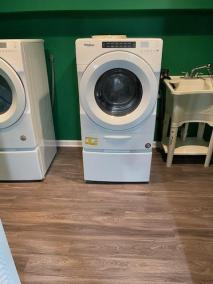 13 26 - LVP Installed In Laundry And Bath Rooms