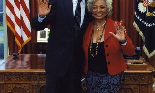 President Obama and Nichelle Nichols flash the Vulcan greeting.