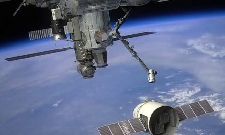 Breaking News:  SpaceX's Dragon Docking In Progress