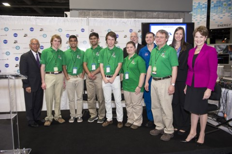 Orion Exploration Design Challenge Winning Team from Hampton,Va NASA's Administrator, Charles Bolden (left), President/CEO of Lockheed Martin, Marillyn Hewson (right), and astronaut Rex Walheim (back row) pose for a group photo with the winning high school team in the Exploration Design Challenge. Team ARES from the Governors School for Science and Technology in Hampton, Va. won the challenge with their radiation shield design, which was built and flown aboard the Orion/EFT-1. Credit: NASA/Aubrey Gemignani