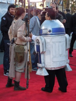 """Lisa Curtis-Saunders as """"Rey"""" is interviewed by Guillermo-2-D2 for the Jimmy Kimmel Show."""