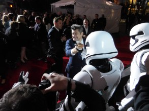 Andy Serkis clasps hands with a trooper/