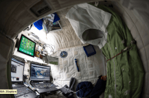 """(04/24/2015) --- NASA astronaut Scott Kelly on the International Space Station shows off his personal living quarters in space. Scott tweeted this image out with the comment: """" My #bedroom aboard #ISS. All the comforts of #home. Well, most of them. #YearInSpace"""". (Flickr: nasa2explore)"""