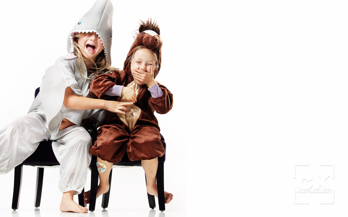Chris Kryzanek Photography children - sisters in costumes laughing
