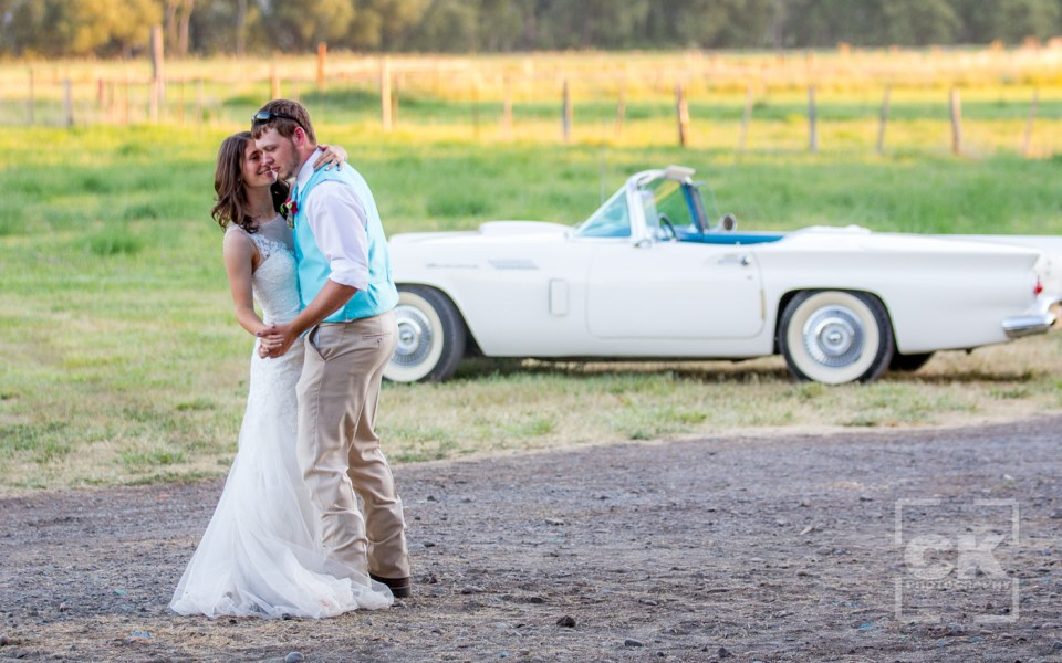 Chris Kryzanek Photography - Bride and grrom dancingin front of Thunderbird