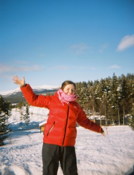 Ksenia at Dombås with snowy hills in the background (not the most flattering shot)