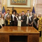 Students and teacher gather at Governor's desk for Theatre in Our Schools Day 2020.