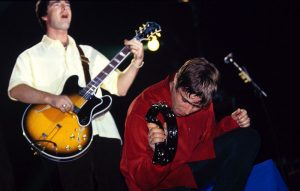 Noel and Liam Gallagher live with Oasis in 1997
