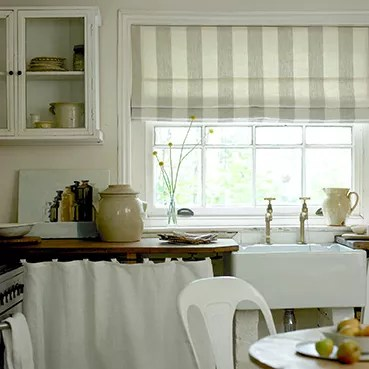 curtains for the kitchen hood sale or blinds a which one is right you ideal home pole threads straight through metal rimmed eyelet combining and roman blind as seen here creates softer look