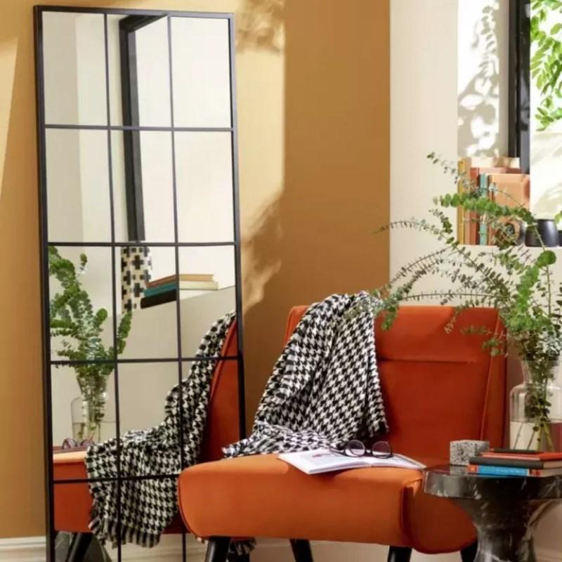 Habitat Windowpane Full Length Wall Mirror leaning on wall beside orange chair bed