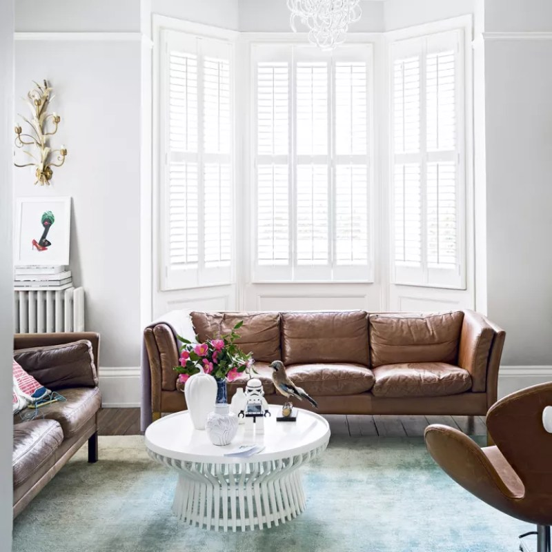 Modern white living room with leather sofa