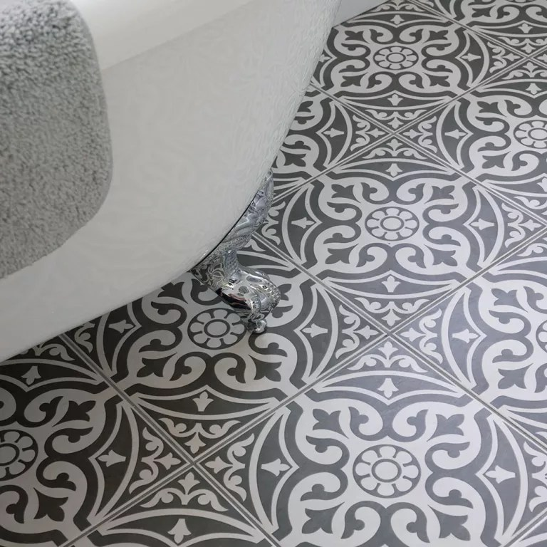 Bathroom with rolltop bath and patterned floor tiles