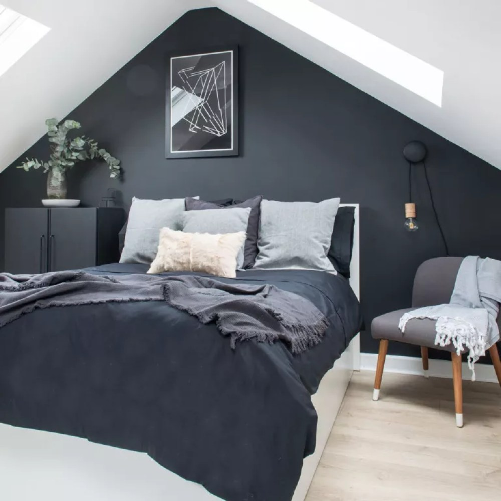 Attic bedroom with black feature wall