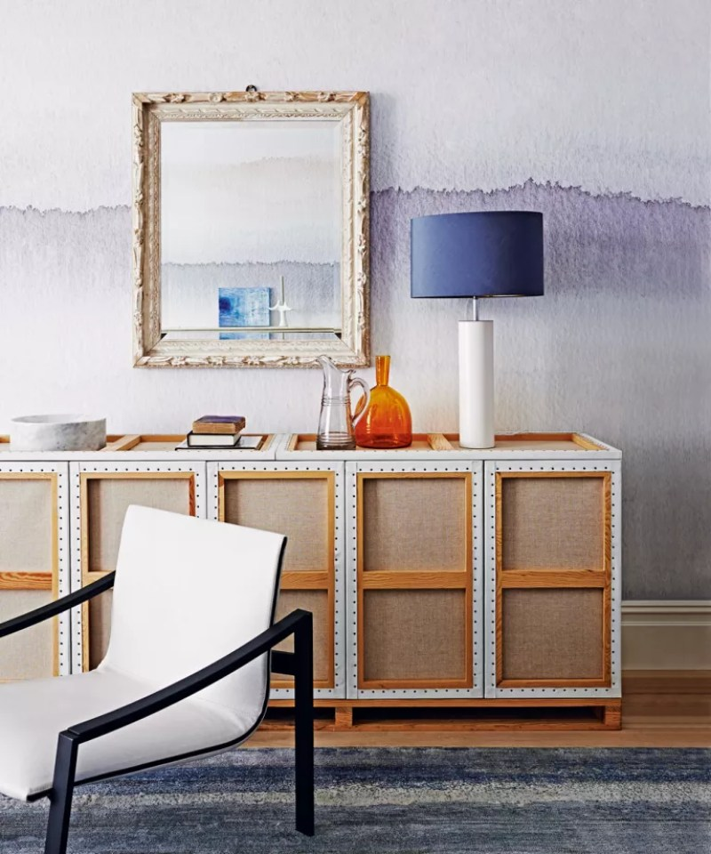 Living room faded watercolour wallpaper design behind sideboard