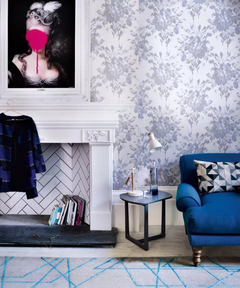 pixelated floral wallpaper in modern living room with metro tiled fireplace