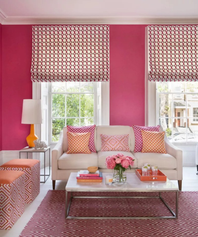 Pink living room with white floorboards and patterened pink rug