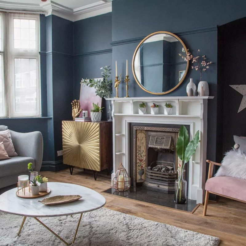 blue living room with white marble fireplace