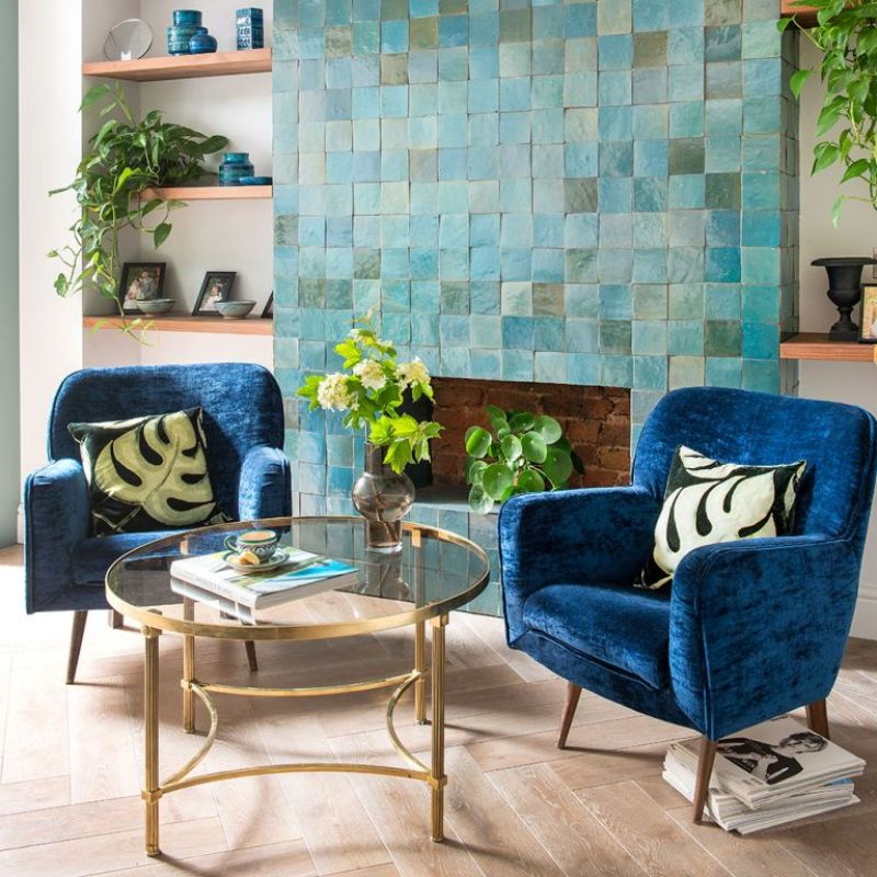 Living room with green and blue tiled chimney breast feature wall