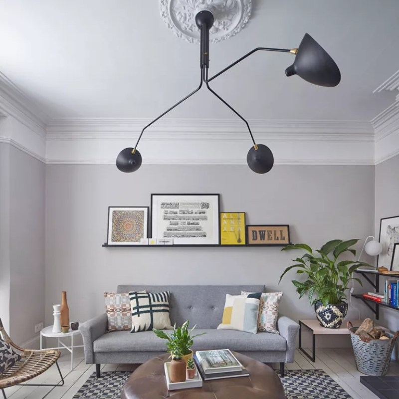 grey loving room with sculptural ceiling